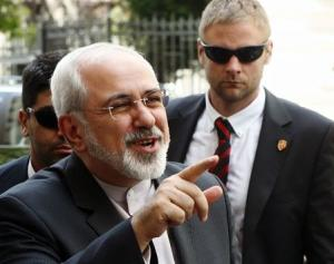 Iranian Foreign Minister Mohammad Javad talks to journalists as he arrives at his embassy in Vienna