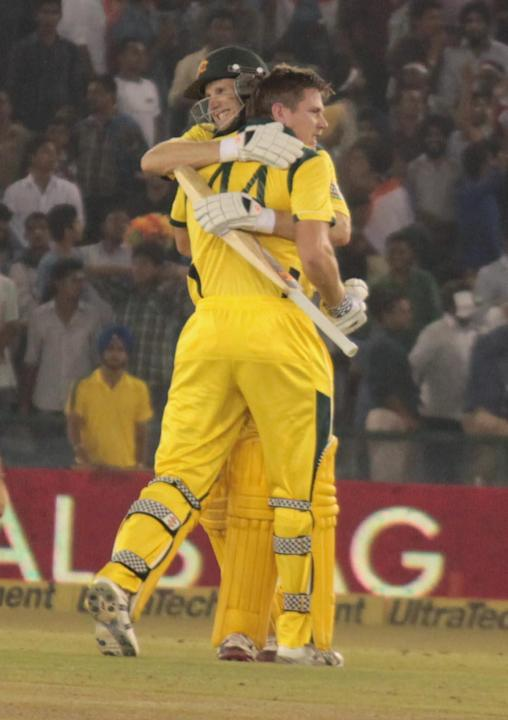 AC Voges hugs JP Faulkner after winning the 3rd ODI between India and Australia at Punjab Cricket Association Stadium, Mohali, Chandigarhon Oct. 19, 2013. (Photo: IANS)