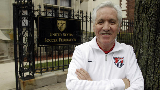 Tom Sermanni, new coach of the United States women's soccer team, poses for a photo outside the United States Soccer Federation Headquarters after an interview with The Associated Press, Tuesday, Oct. 30, 2012, in Chicago. Sermanni was hired Tuesday to replace Pia Sundhage, who led the Americans to back-to-back Olympic gold medals and their first World Cup final in 12 years. Sermanni has spent the last eight years as Australia's coach, taking the Matildas to the quarterfinals of the last two Women's World Cups. (AP Photo/M. Spencer Green)