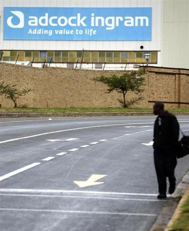 A man walks past the Adcock Ingram offices in Johannesburg