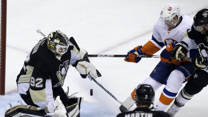 Pittsburgh Penguins goalie Tomas Vokoun (92) stops a shot by New York Islanders'  Brad Boyes (24) during the first period of Game 5 of an NHL hockey Stanley Cup first-round playoff series, Thursday, May 9, 2013, in Pittsburgh. (AP Photo/Gene J. Puskar)