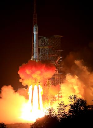 In this photo released by China's Xinhua News Agency, the Long March 3B rocket carrying the Chang'e-3 lunar probe blasts off from the launch pad at Xichang Satellite Launch Center, southwest China's Sichuan Province, Monday Dec. 2, 2013. It will be the first time for China to send a spacecraft to soft land on the surface of an extraterrestrial body, where it will conduct surveys on the moon. (AP Photo/Xinhua, Li Gang) NO SALES