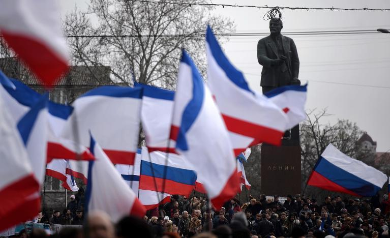 Russian flags flood Crimean capital as thousands back takeover