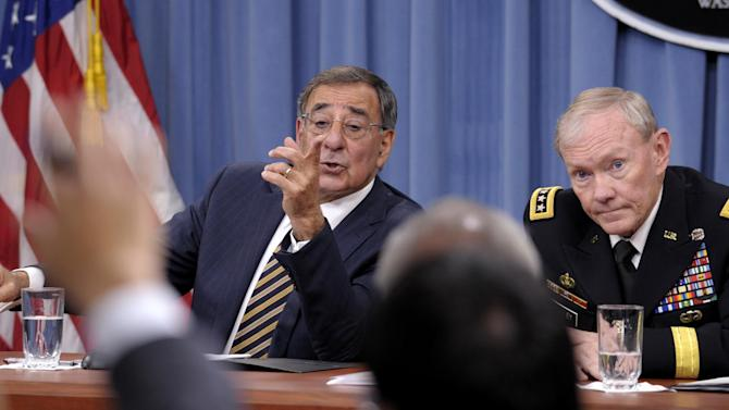 FILE - In this this May 10, 2012 file photo, Defense Secretary Leon Panetta and Joint Chiefs Chairman Gen. Martin E. Dempsey take part in a news conference at the Pentagon in Washington, on the defense budget. Is the U.S. spending enough money on defense, and is it spending it in the right ways? In the aftermath of the 9/11 terrorist attacks the money spigot was turned wide open, pouring hundreds of billions of dollars into the wars in Iraq and Afghanistan and expanding the armed forces. Now that's changing, and an important issue in the election is whether budget cuts have gone too far. (AP Photo/Susan Walsh)