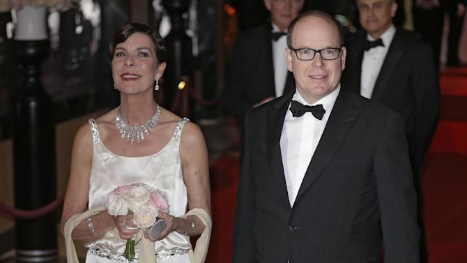 Prince Albert II of Monaco, and his wife Princess Charlene pose for photographers as they arrive at the Rose Ball in Monaco, Saturday, March 28, 2015. The Rose Ball is the traditional annual charity event in the Principality of Monaco. (AP Photo/Lionel Cironneau)