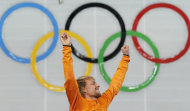 Gold medallist Michel Mulder of the Netherlands raises his hands in celebration during the flower ceremony for the men's 500-meter speedskating race at the Adler Arena Skating Center at the 2014 Winter Olympics, Monday, Feb. 10, 2014, in Sochi, Russia. (AP Photo/Patrick Semansky)