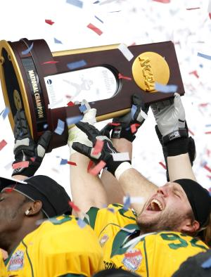 FILE - In this Jan. 7, 2012, file photo North Dakota State defensive end Coulter Boyer (92) celebrates with teammates after defeating Sam Houston State 17-6 in the Football Championship Subdivision championship NCAA college football game in Frisco, Texas. A group of FCS officials including university presidents, athletic directors and conference commissioners has recommended that the current playoff bracket be expanded from 20 to 24 teams. The new system, which is expected to pass and go into place for the 2013 season, would seed the top eight teams and give them first-round byes and home games in the following round.  (AP Photo/LM Otero, File)