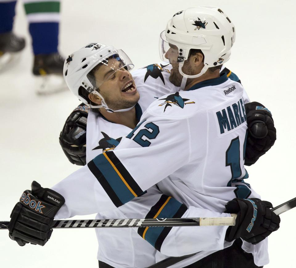 Sharks stay unbeaten with 4-1 win over Canucks