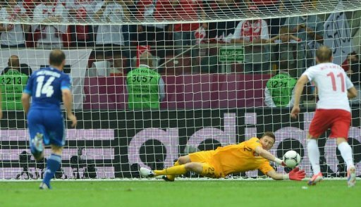 Polish goalkeeper Przemyslaw Tyton stops a penalty