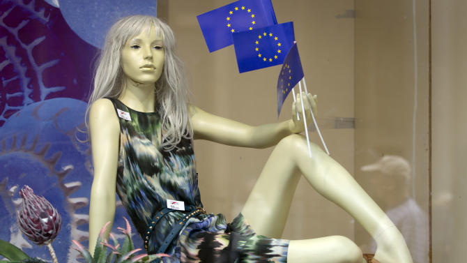 A window mannequin with EU flags is on display in a shop in downtown in Zagreb, Croatia, Sunday, June 30, 2013. Croatia is to join the European Union on July 1, 2013. Fireworks are ready and foreign leaders are arriving as Croatia celebrated on Sunday its entry into the European Union some 20 years after winning independence in a bloody civil war that shook the continent. Croatia will become the 28th EU member on Monday, the bloc's first addition since Bulgaria and Romania joined in 2007. (AP Photo/Darko Bandic)