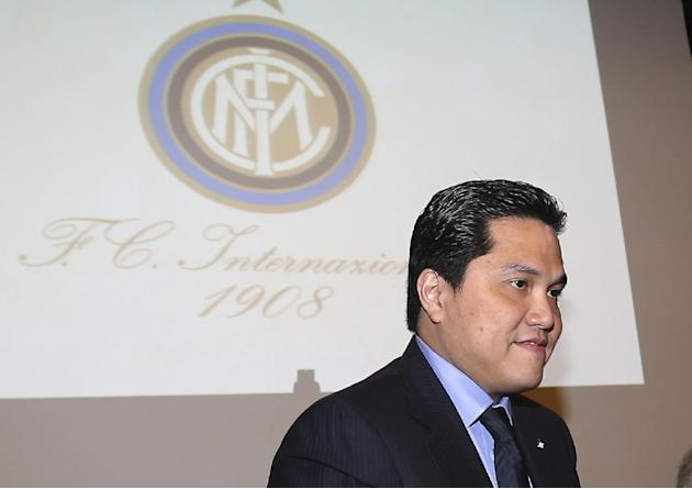 Inter Milan newly elected President Erick Thohir poses next to the club's logo in Milan, Italy, Friday, Nov. 15, 2013. Inter Milan owner Erick Thohir has been elected as club president, ending Massimo
