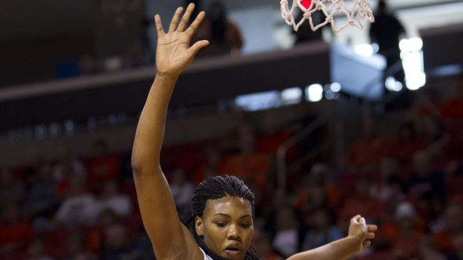 Auburn forward Jassany Williams (25) attempts to block the shot of Tennessee forward Alicia Manning (15) in the first half of their NCAA college basketball game in Auburn, Ala., Sunday, Jan. 1, 2012. (AP Photo/Dave Martin)