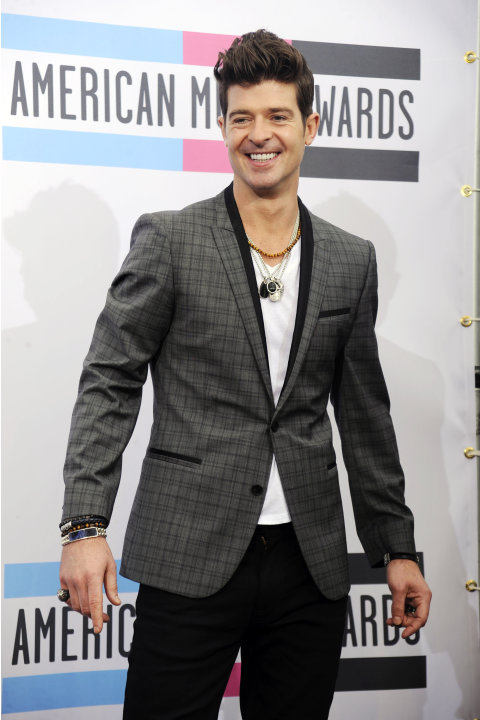 FILE - In this Sunday, Nov. 20, 2011 file photo, Robin Thicke poses backstage at the 39th Annual American Music Awards, in Los Angeles.  R&B singer Robin Thicke is a mentor on the new ABC singing seri