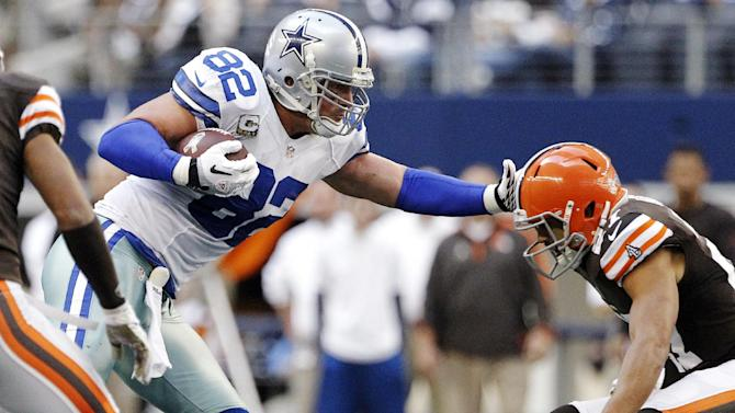 Cleveland Browns free safety Eric Hagg, right, attempts to bring down Dallas Cowboys' Jason Witten (82) in the second half of an NFL football game, Sunday, Nov. 18, 2012, in Arlington, Texas. (AP Photo/Brandon Wade)