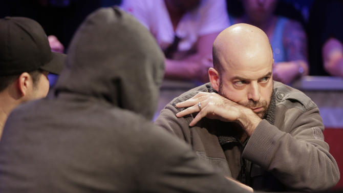 Amir Lehavot checks an opposing player during a hand of Texas Hold'em at the World Series of Poker, Monday, July 15, 2013, in Las Vegas. (AP Photo/Julie Jacobson)