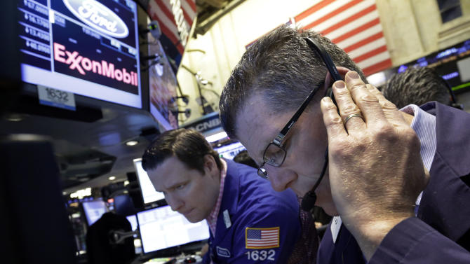 Specialist Gregg Maloney, left, works with a trader on the floor of the New York Stock Exchange, Friday, June 21, 2013. U.S. stocks rose in morning trading on Friday as traders regrouped following the biggest drop of the year. (AP Photo/Richard Drew)
