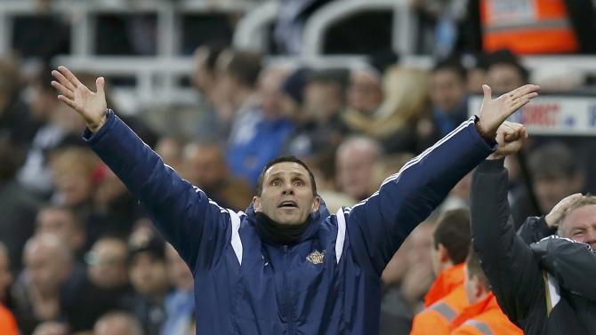 Sunderland manager Gustavo Poyet reacts after Adam Johnson scored a goal against Newcastle during their English Premier League soccer match at St James' Park in Newcastle