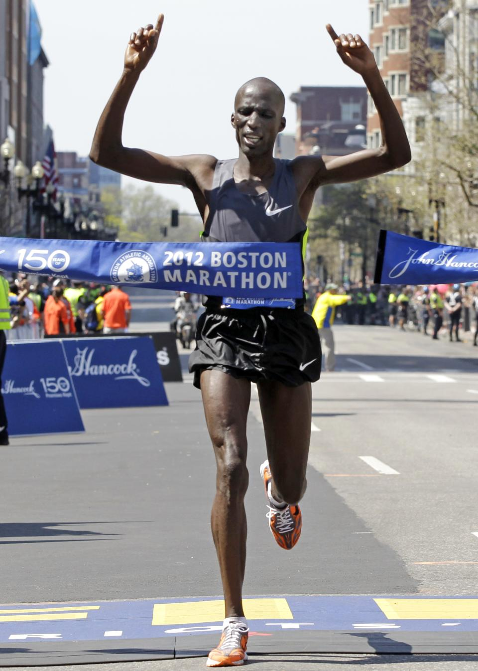 Wesley Korir of Kenya crosses the finish line to win the men's division of the 2012 Boston Marathon in Boston, Monday, April 16, 2012. (AP Photo/Elise Amendola)