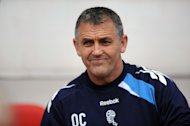 Owen Coyle will take relegated Bolton to play Burnley on the first day of the Championship season