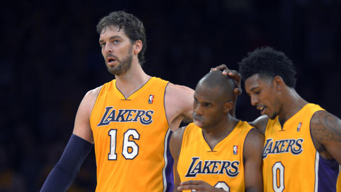 Los Angeles Lakers center Pau Gasol, left, of Spain, guard Jodie Meeks, center, and forward Nick Young celebrate in the closing seconds of an NBA basketball game against the Utah Jazz, Friday, Jan. 3, 2014, in Los Angeles