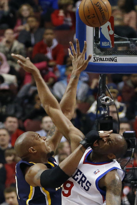 Indiana Pacers' David West, left, goes up to shoot against Philadelphia 76ers' James Anderson during the second half of an NBA basketball game on Friday, March 14, 2014, in Philadelphia. India
