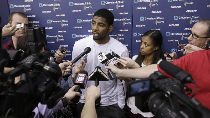 Cleveland Cavaliers' Kyrie Irving talks to the media at a news conference about the firing of head coach Byron Scott. Thursday, April 18, 2013, in Independence, Ohio. The Cavaliers fired Scott after three losing seasons. (AP Photo/Tony Dejak)