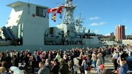 Family and friends cheer as HMCS Charlottetown returns to its home port in Halifax.