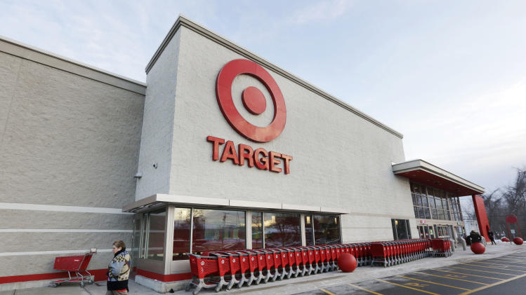 A passer-by walks near an entrance to a Target retail store Thursday, Dec. 19, 2013 in Watertown, Mass. Target says that about 40 million credit and debit card accounts may have been affected by a data breach that occurred just as the holiday shopping season shifted into high gear. (AP Photo/Steven Senne)