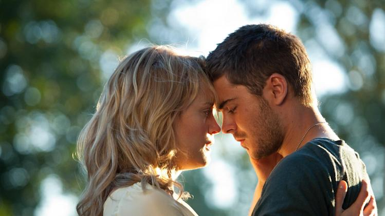 "In this film image released by Warner Bros, Taylor Schilling, left, and Zac Efron are shown in a scene from ""The Lucky One."" (AP Photo/Warner Bros., Alan Markfield)"