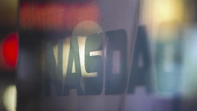 A logo is seen on a window outside of the Nasdaq MarketSite building in New York's Times Square