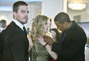 Stephen Amell, Emily Bett Rickards and David Ramsey | Photo Credits: Cate Cameron/The CW