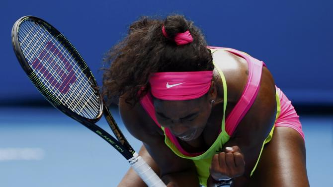 Williams of the U.S. reacts after winning a point against Muguruza of Spain  during their women's singles fourth round match at the Australian Open 2015 tennis tournament in Melbourne