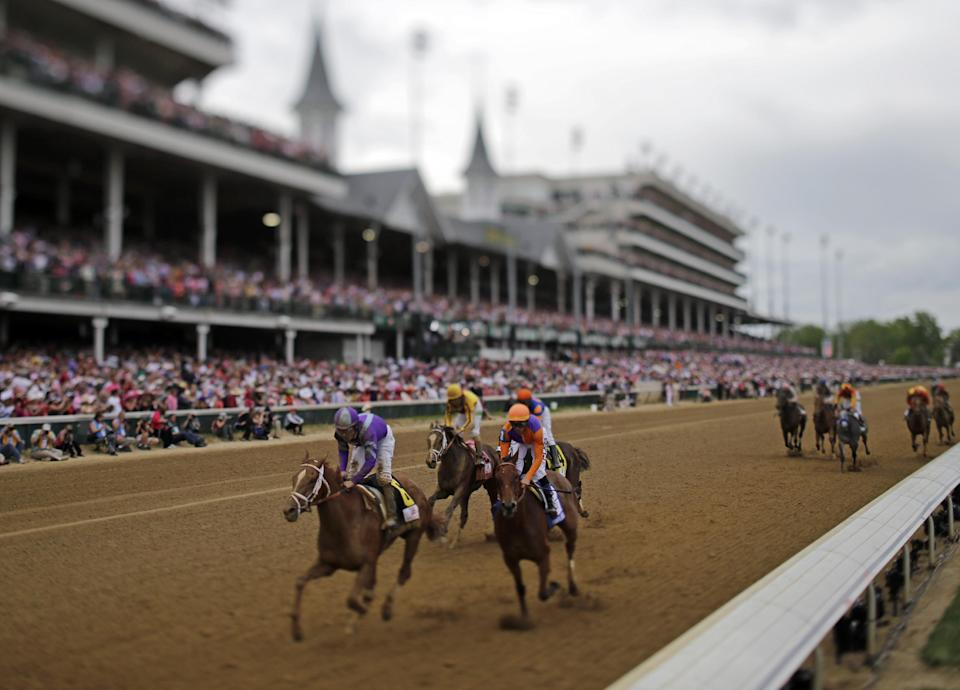 In this image made with a specialty lens, Mike Smith rides Princess of Sylmar to a win in the 139th Kentucky Oaks at Churchill Downs Friday, May 3, 2013, in Louisville, Ky. (AP Photo/Matt Slocum)