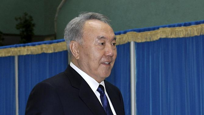 Kazakhstan's President and presidential candidate Nazarbayev leaves polling station after casting his vote during snap presidential election in Astana