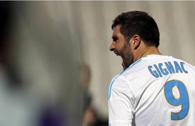 Olympique Marseille's Gignac celebrates after scoring against Bastia during their French Ligue 1 match in Marseille