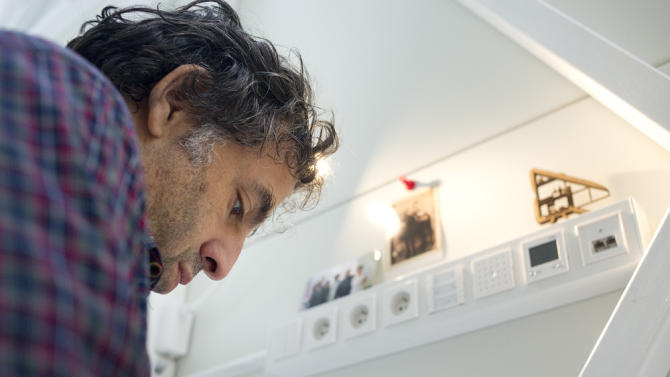 World's thinnest house Keret working at desk