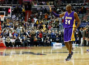 Kobe Bryant of the Los Angeles Lakers waves to the …
