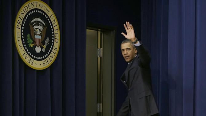 President Barack Obama waves as he leaves the South Court Auditorium of the Eisenhower Executive Office building on the White House complex in Washington, Tuesday, Feb. 19, 2013, after he spoke about the sequester; standing with emergency responders, a group of workers the White House says could be affected if state and local governments lose federal money as a result of budget cuts.  (AP Photo/Charles Dharapak)