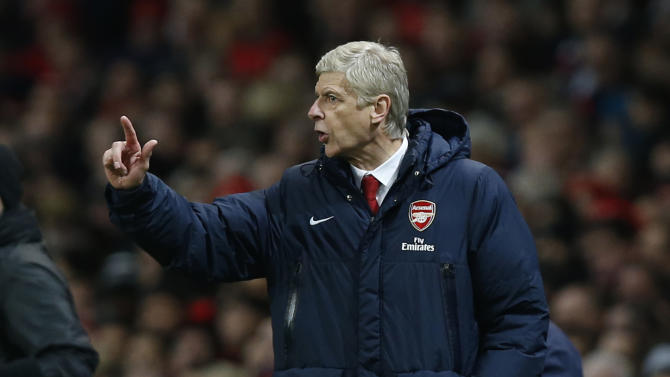Arsenal's manager Arsene Wenger gestures as he watches his team play against Crystal Palace during their English Premier League soccer match at Emirates Stadium in London, Sunday, Feb. 2, 2014. (AP Photo/Sang Tan)