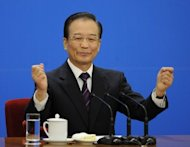 Chinese Premier Wen Jiabao, pictured in March 2012, said the yuan was close to reaching a balanced level and vowed to improve the flexibility of the unit, despite persistent international criticism of Beijing's currency controls