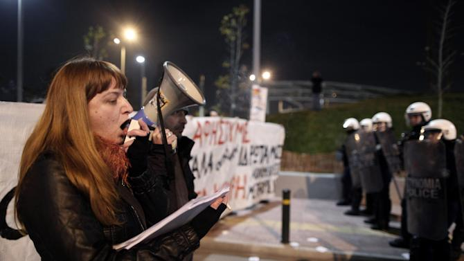In this photo made Thursday, Feb. 18, 2013, unemployed worker Maria Kanga chants slogans using a loudspeaker during a protest in central Athens. Kanga, a mother of two, was laid off when a record store chain went out of business last year but is still owed five months' pay and severance money. Researchers from Greece's largest labor union, the GSEE, say the country's three-year crisis has left nearly two-thirds of private sector employees without receiving their regular salaries. GSEE has called a general strike for Wednesday Feb. 20. (AP Photo/Petros Giannakouris)