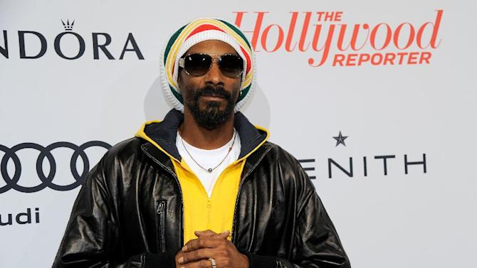 Snoop Dogg arrives at The Hollywood Reporter Nominees' Night at Spago on Monday, Feb. 4, 2013, in Beverly Hills, Calif. (Photo by Chris Pizzello/Invision for The Hollywood Reporter/AP Images)