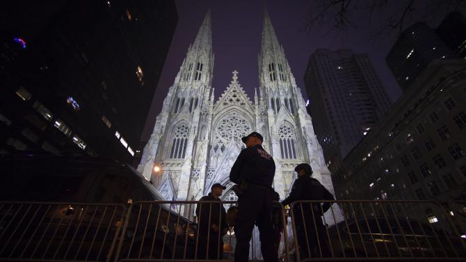 Police stand guard outside St Patrick's Cathedral during midnight mass in the Manhattan borough of New York