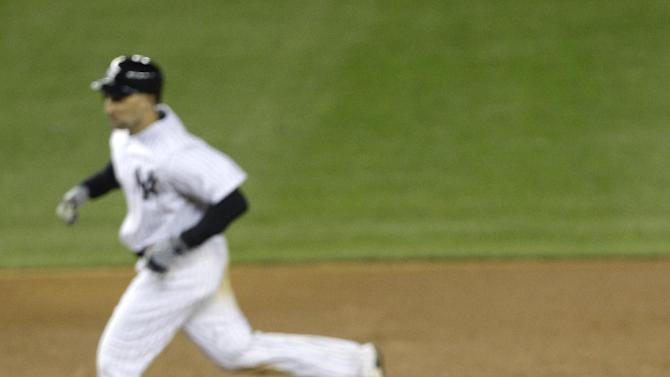 New York Yankees left fielder Raul Ibanez runs the bases around Detroit Tigers pitcher Jose Valverde after hitting a two-run home run in Game 1 of the American League championship series Saturday, Oct. 13, 2012, in New York. (AP Photo/Kathy Willens)