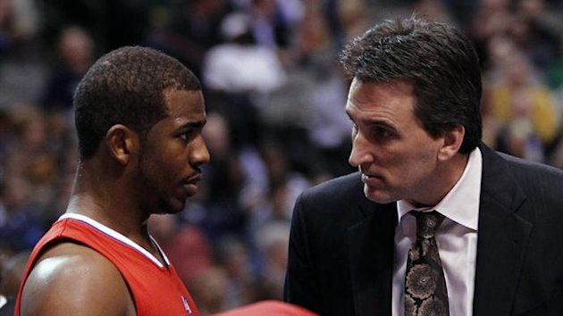 NBA Former Los Angeles Clippers head coach Vinny Del Negro (R) talks with guard Chris Paul