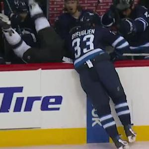 Byfuglien bulldozes Muzzin into the bench