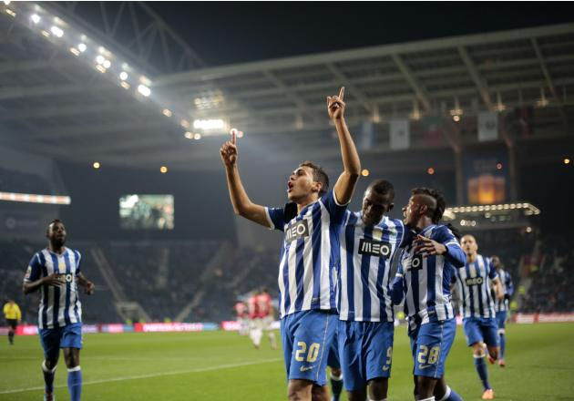 Porto's Carlos Eduardo celebrates his goal against Olhanense with his teammates during their Portuguese Premier League soccer match at Dragao stadium in Porto