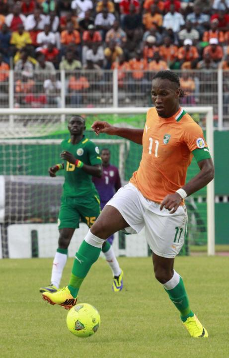 Ivory Coast's Didier Drogba controls the ball during their 2014 World Cup qualifying soccer match against Senegal in Abidjan