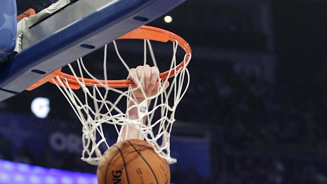 Western Conference's Kevin Love (42), of the Minnesota Timberwolves, dunks on Eastern Conference's Dwight Howard (12), of the Orlando Magic, during the first half of the NBA All-Star basketball game, Sunday, Feb. 26, 2012, in Orlando, Fla. (AP Photo/Chris O'Meara)