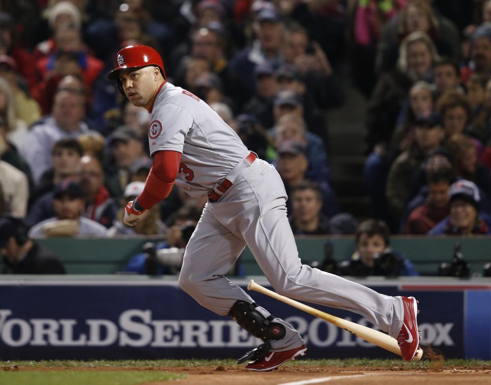 St. Louis Cardinals' Carlos Beltran runs after hitting a single off Boston Red Sox starting pitcher John Lackey during the first inning of Game 2 of baseball's World Series Thursday, Oct. 24, 2013, in Boston. (AP Photo/Elise Amendola)